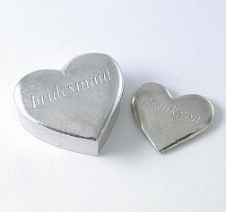 Elegant pewter box with a small heart inside to give as a gift to the ladies in the wedding party.
