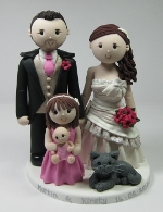 A wedding cake topper featuring all the family from Artlocke Designs