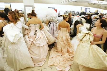 brides-to-be trying on their dream dresses  at the 'running of the brides' event in the US