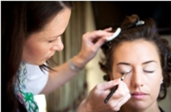 Katie Dale applying make-up to the bride on her big day