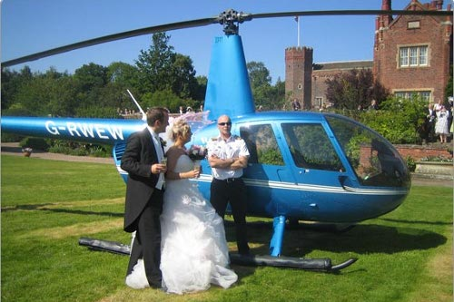 Wedding couple arrive in style by helicopter