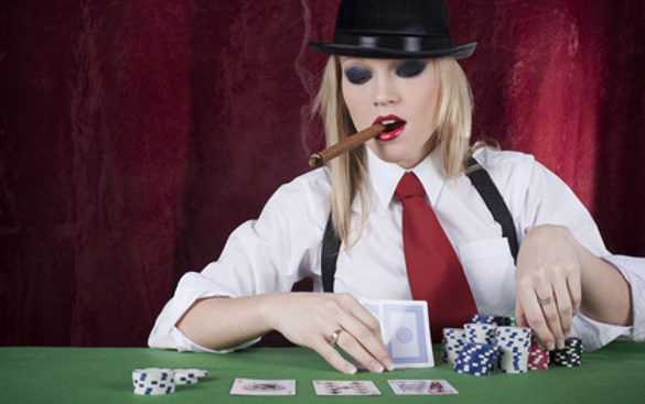 Lady dealing the cards and smoking a cigar