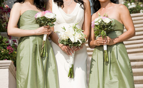 A complimentary colour theme of pale green with an ivory wedding dress